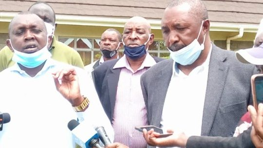 File image of Kimani Wambugu flanked with other politicians allied to DP Ruto